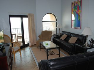 Wild Dunes condo photo - Lovely Living Room with Balcony access!