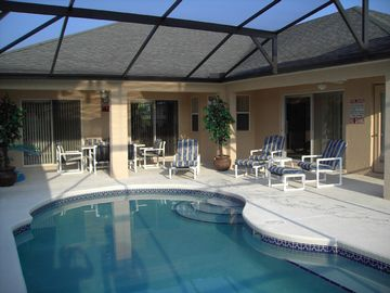 South Facing Pool with generous lanai, ceiling fans, Patio furniture. BBQ.
