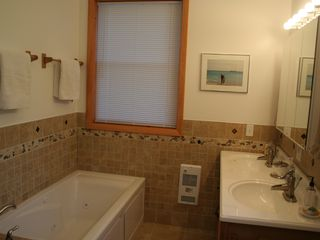 Eastbrook house photo - 1st floor master bath, jetted tub, dual sinks. All towels and linens provided.