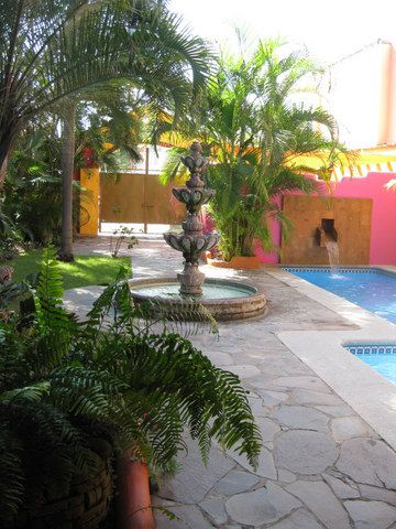 ENTRY COURTYARD WITH LARGE FOUNTAIN