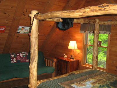 2nd floor bedroom 2 with log style 'full size' futon w/view into woods.