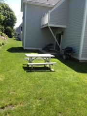 York Beach condo photo - Picnic table along with a Gas BBQ grill in the back for those summer moments