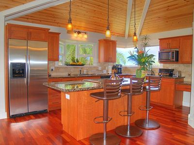 Fully equipped kitchen with access to lanai.Ample seating for large crowds
