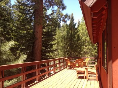 Enjoy the afternoon on the spacious deck surrounded by trees.