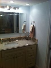downstairs master bath with plenty of lighting - Indian Shores condo vacation rental photo
