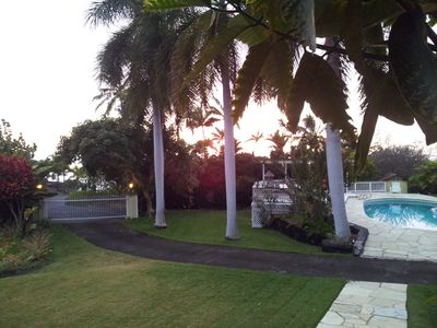 Entry gate to the property and pool at sunset