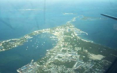 Marsh harbour with Sugarloaf cay right below the Airplane tail