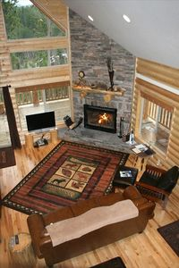 Great room with flat screen tv and wood burning fireplace