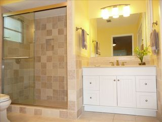 Sanibel Island house photo - Enormous master bath with his and her vanities and dual shower heads
