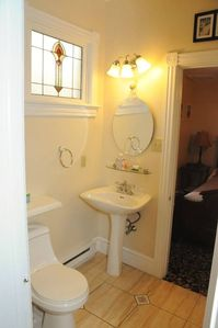 Holly Bathroom with Antique Stained Glass Window and Shower