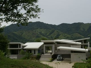 Nicoya house photo - The main house as you arrive. Guest house is a separate structure located here.