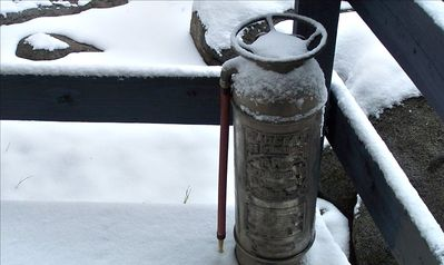 Old fire extinguisher on front stoop