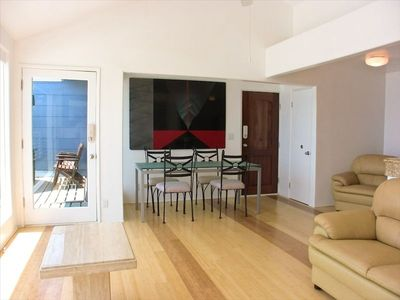 hardwood floors, open dining area