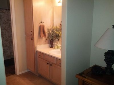 Ensuite bathroom area with walk in closet and 3 piece bathroom