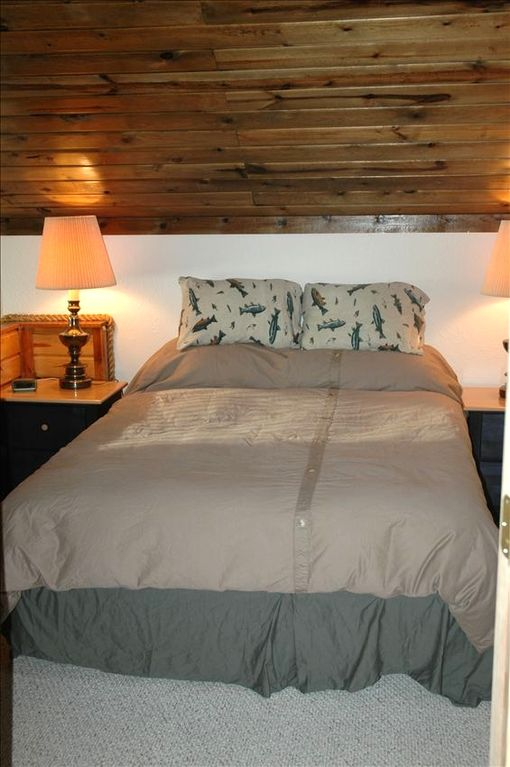 Upstairs bedroom with a queen sized bed