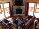 Great Room fireplace with hand carved mantle - Sevierville cabin vacation rental photo