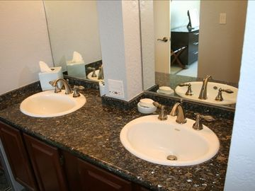Master Bathroom with Granite Countertops and Travertine Tile!