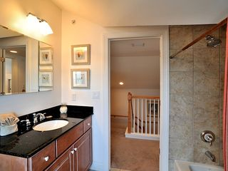Key West townhome photo - The fourth bathroom has tub and shower.