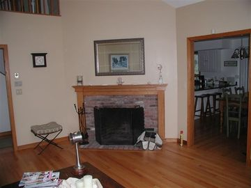 Living Room w/ Fireplace connecting to dining area