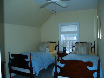 Twin bedroom with a view of the village and Pomfret hills beyond