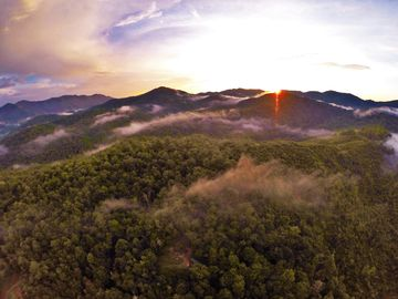 Lake Nantahala cabin rental - Sunset over the Nantahala National Forest backyard. Can you see the cabin?
