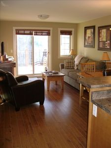 Bright cheery living-room with hardwood floors, TV/DVD and fireplace