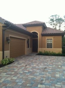 Front entrance, with 2-car garage and paver driveway.