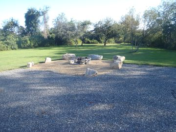 1.5 Acre Yard with fire pit. Jenness Beach just behind the trees!
