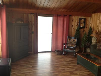 Full view of Living room with armoire and tv