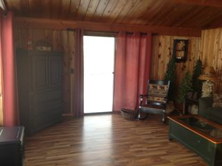 Elk Rapids cottage photo - Full view of Living room with armoire and tv