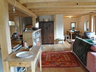 Mezzano barn photo - Entering the middle common living floor, the kitchen, sitting and dining nook