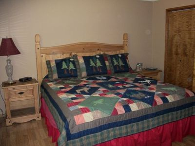 Bend house rental - The master bedroom features a king bed and flat screen TV in adjacent armoire