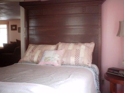 Niantic house rental - Bedroom with full bed and water views.