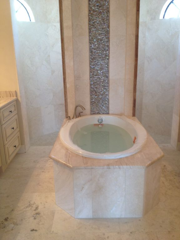Master bath w/Jacuzzi tub framed by the illusion of a waterfall &Rainfall shower