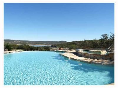 Infinity Edge Pool and Spa at The Beach Club with Lake Travis views.
