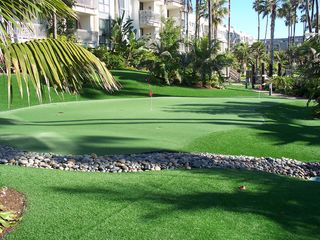 Oceanside condo photo - Putting green and play area outside your front door