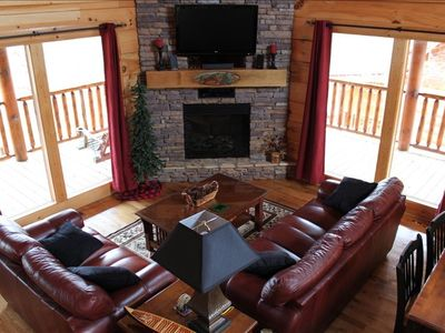 Great Room has hand carved mantle, leather seating for 6 & home theater system