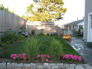 West Dennis house photo - Bright and flowered yard
