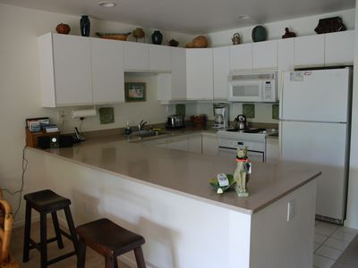 Full Kitchen with utensils, kitchen tools and appliances.