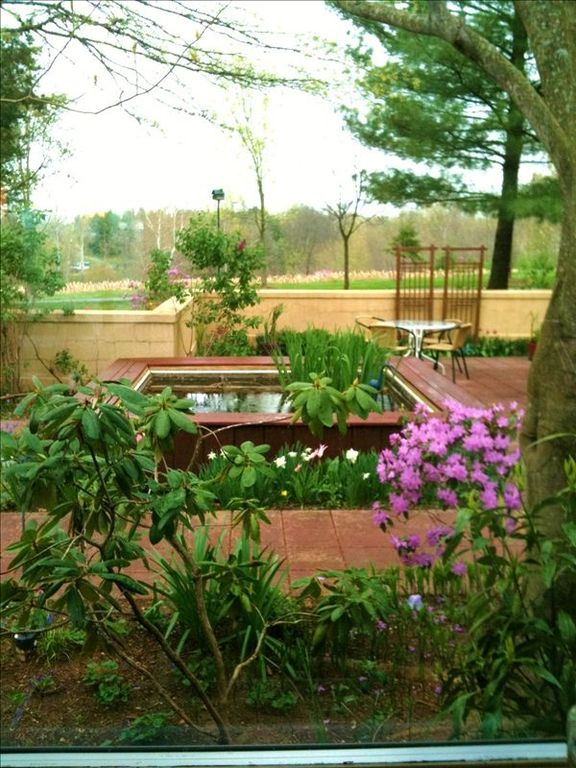 Kitchen window rewards your chef with view of dining patio, fountain, flowers.