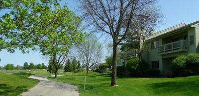 Traverse City condo rental - Quiet park-like setting up north getaway (right side with the private balcony)