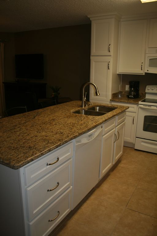 Island with granite counter top with new sink and faucet