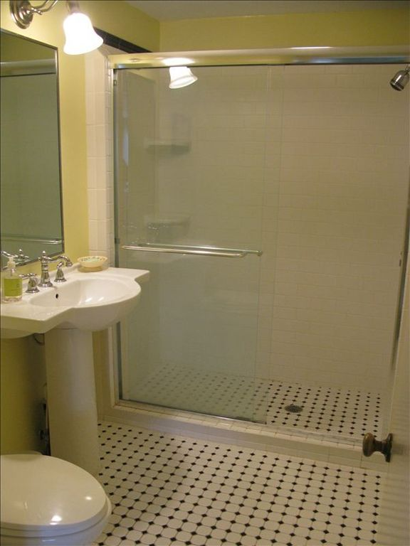 Tiled bathroom with full size shower