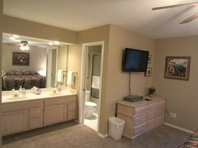 The dual vanity is outside of the master bathroom.