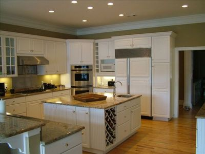 Fabulous chef's kitchen with marble counters and gas stove.