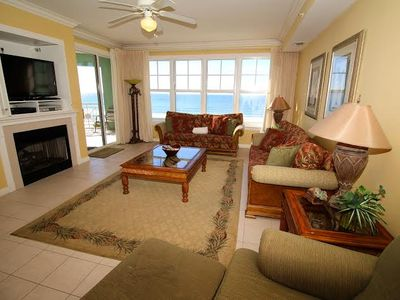 "Living room with Huge 55"" HDTV, balcony access and terrific view of the beach!"