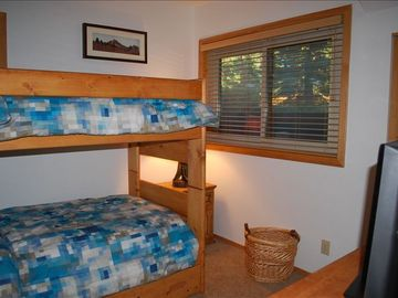 Guest room for kids with 2 bunk beds and a pull out below. Flat panel TV