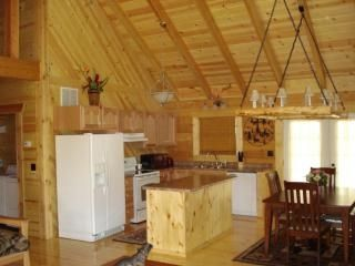Fully stocked kitchen w/ center island. Ice-maker fridge. Glass top stove.
