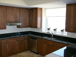Perdido Key condo photo - Kitchen with granite countertops & stainless apps.