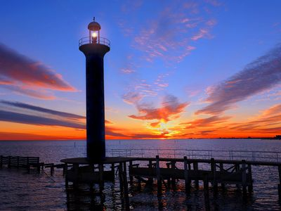 BROADWATER LIGHTHOUSE AT SUNSET WITH FISHING PIER